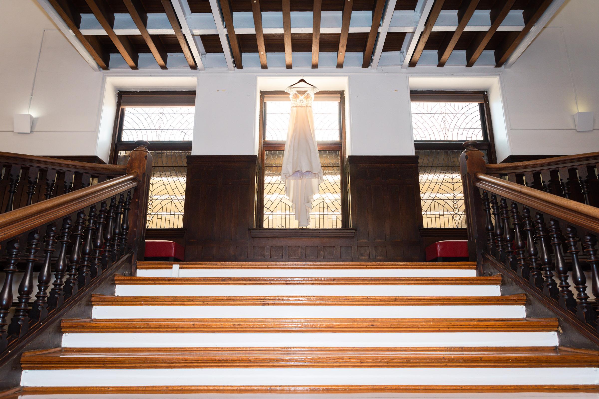 The Baldwin School wedding dress hanging on stairwell
