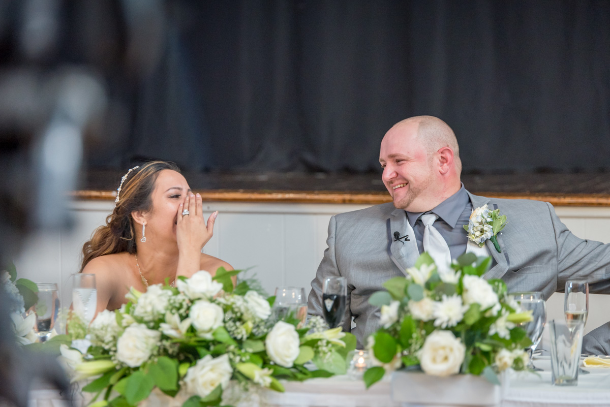bride and groom laughing during wedding speeches sunnybrook ballroom