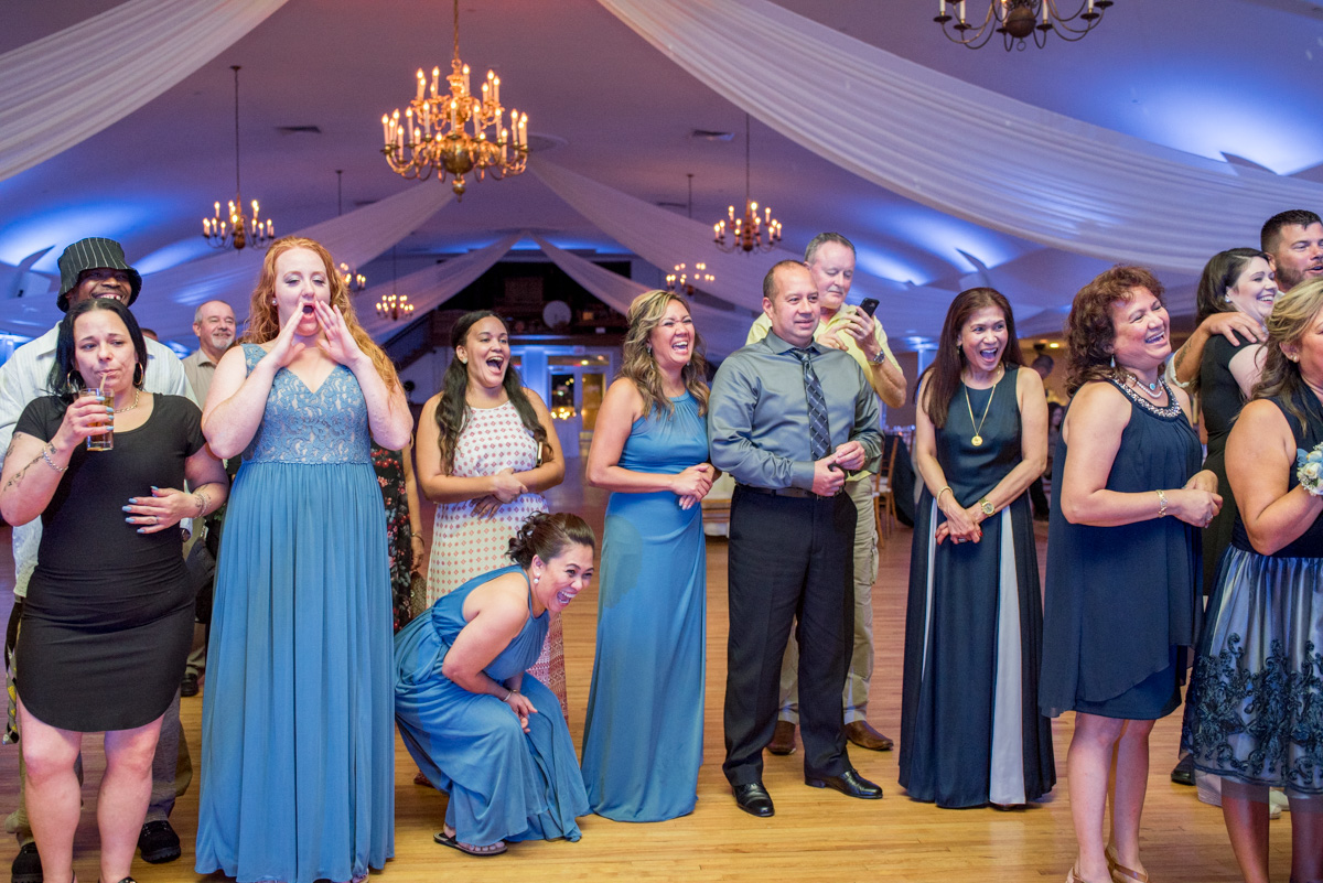 guests reaction to garter wedding photos