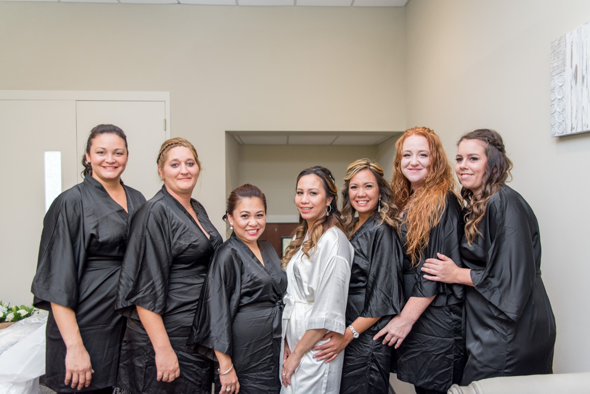 bride with bridesmaids in robes wedding photos