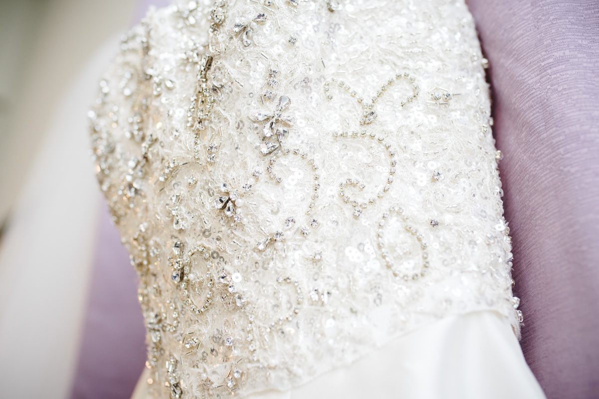 upclose detail of brides wedding dress from Davids Bridal