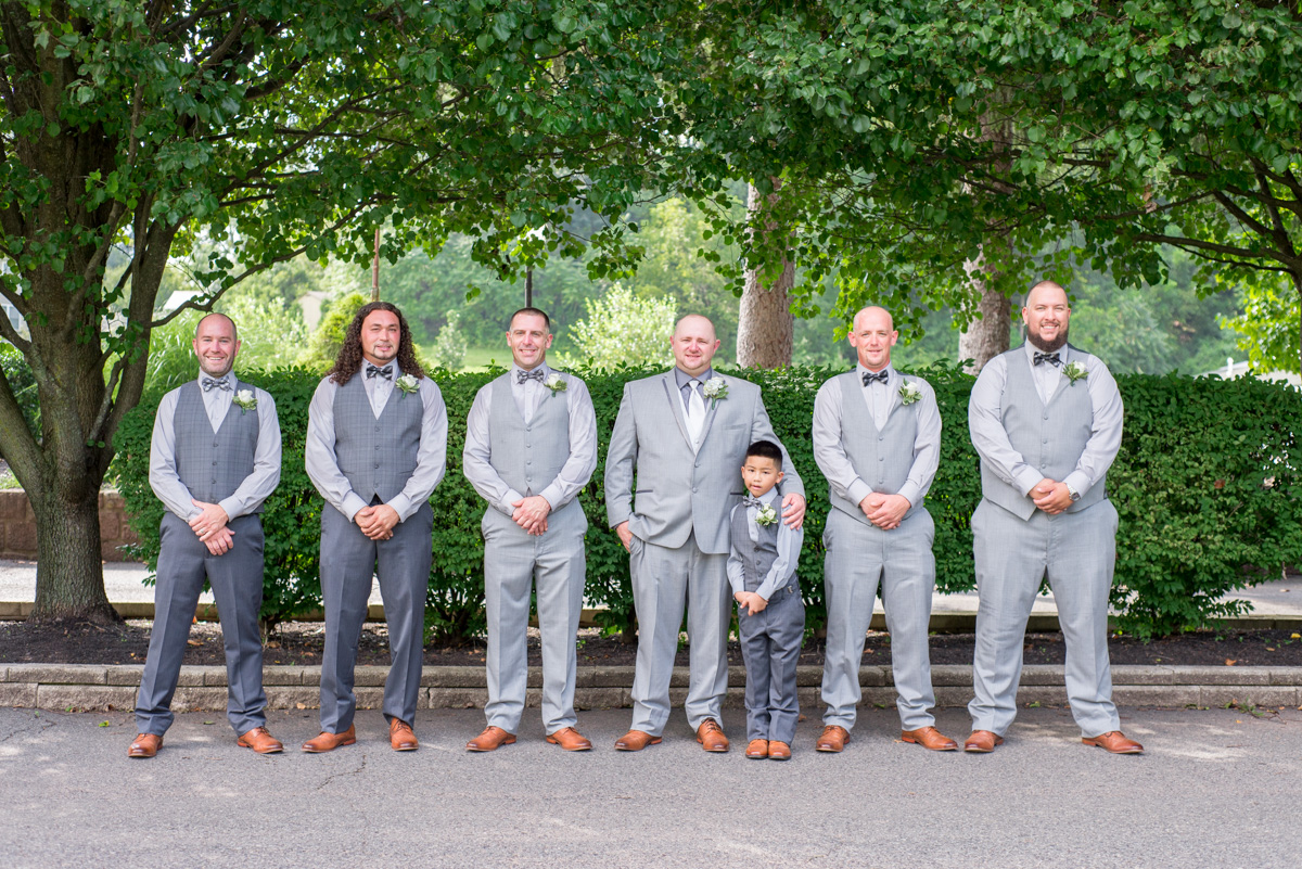groom with groomsment different gray vests suits