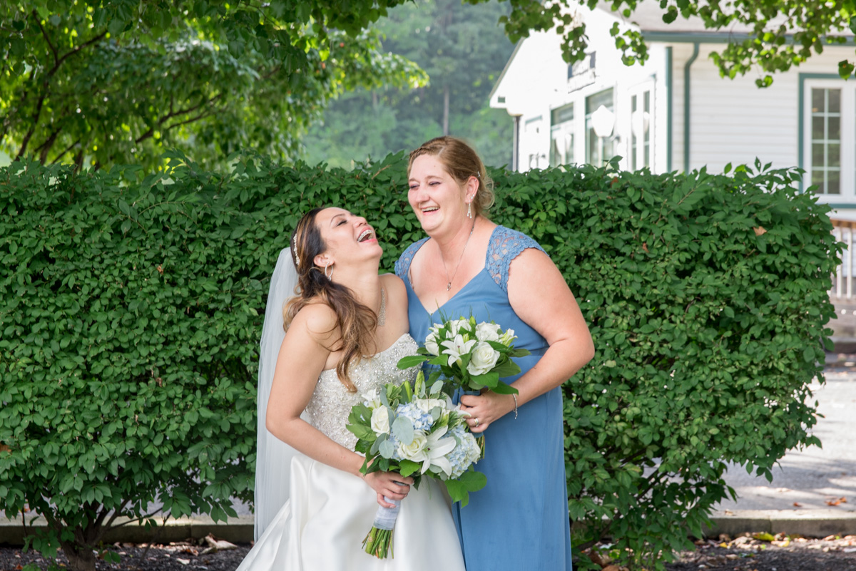 laughing bride and bridesmaid photo